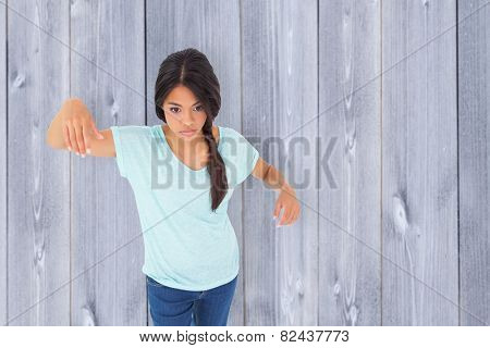 Powerless brunette against wooden planks