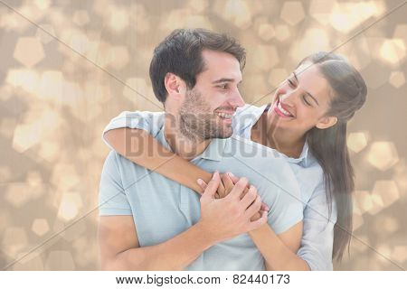Cute couple smiling at each other against light glowing dots design pattern