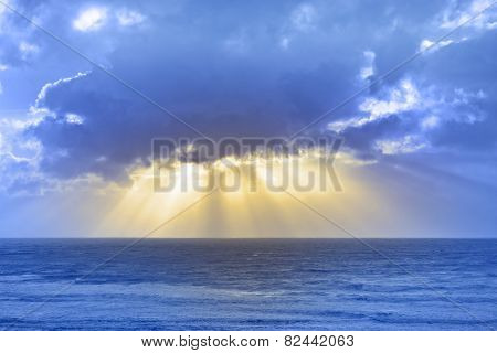 Sun Rays Streaming Through The Storm Clouds