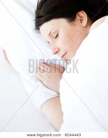 Pretty Young Woman Lying In A Bed Sleeping