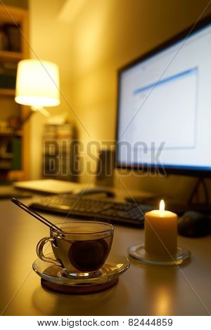Computer And Cup Of Tea On White Desk