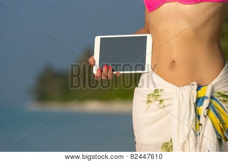 Concept Of Travel. Blank Empty Tablet Computer In The Hands Of Women On The Beach