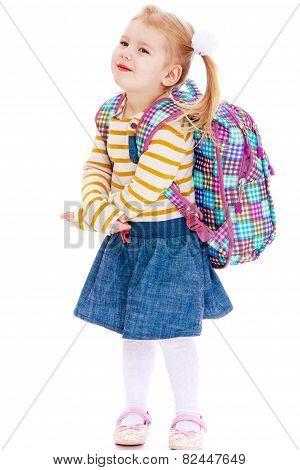beautiful blonde girl schoolgirl with satchel up behind
