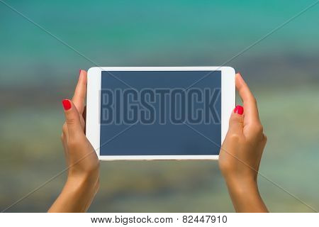 Concept Of Internet And Communication. Blank Empty Tablet Computer In The Hands Of Women On The Beac