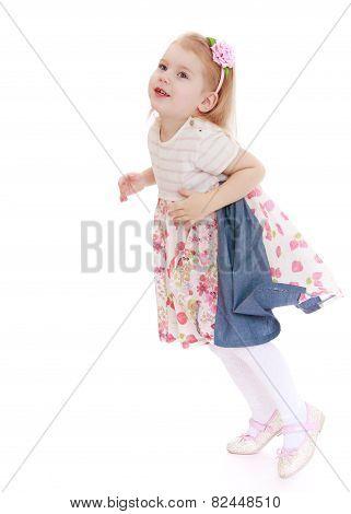 Adorable little girl jumping.