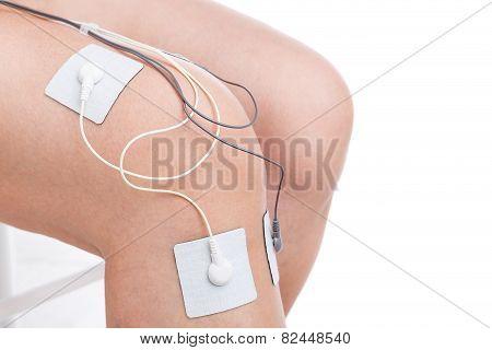 Electrostimulator Massager Treats Knee Trauma. Sports Injuries.