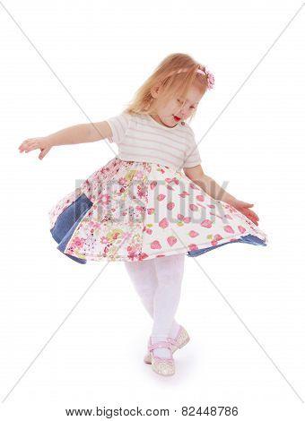 Beautiful little girl spinning around him.