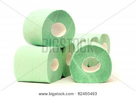 Rolls of a toilet paper on white