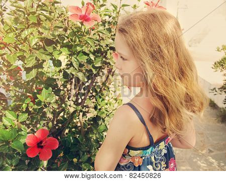 Beautiful Little Girl Is Standing On Flowers Background