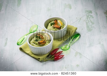 avocado cream with mussel appetizer