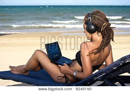 Girl watching movies on the beach
