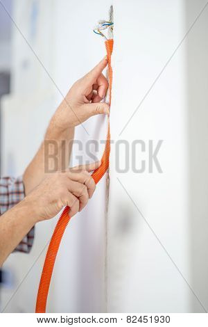 Man Installing Flexible Corrugated Cable Duct