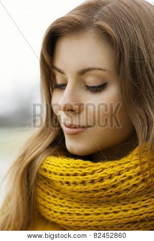 Pretty Woman In A Yellow Knit Scarf With Eyes Closed. Outdoor Portrait.