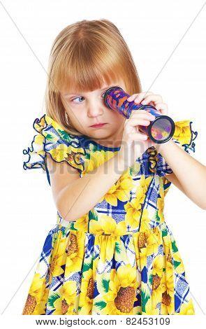 enthusiastic little girl looking into a kaleidoscope.