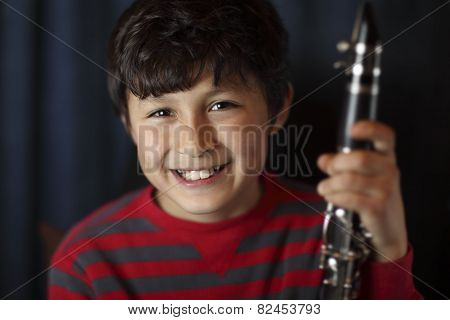 Smiling Boy With Clarinet
