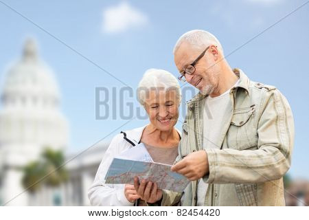 family, age, tourism, travel and people concept - happy senior couple with map over washington white house background