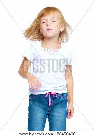 Girl dancing closed her eyes.