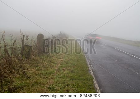 Car Driving On Foggy Winter Road
