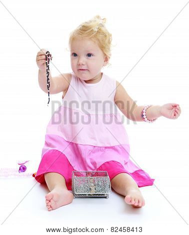 Little girl holding a decoration.