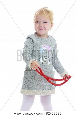 little girl with beads in their hands.