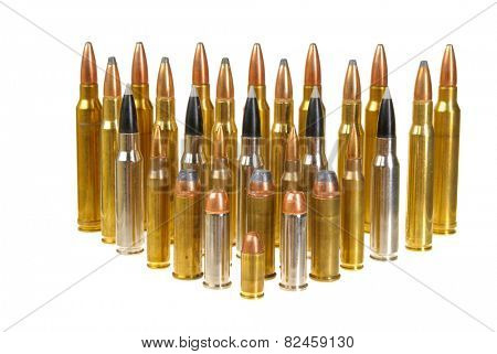 Ammunition of various types and sizes from 320 Auto to 300 Win Mag, arranged in the form of a triangle, isolated on white