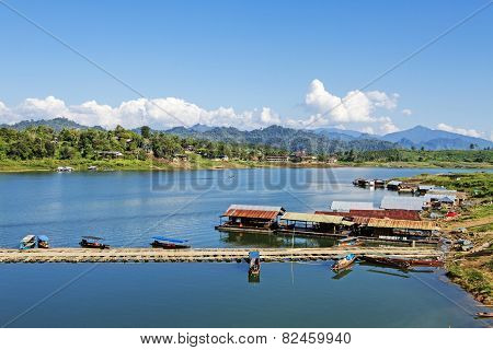 Bamboo Bridge And Houseboat