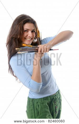 Artist Is Holding Her Brushes With Both Hands