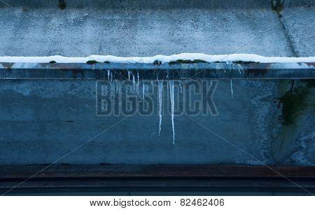 Icicles On The Eaves Of House