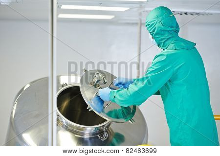 pharmaceutical factory man worker operating mixing machine at pharmacy production industry manufacture factory