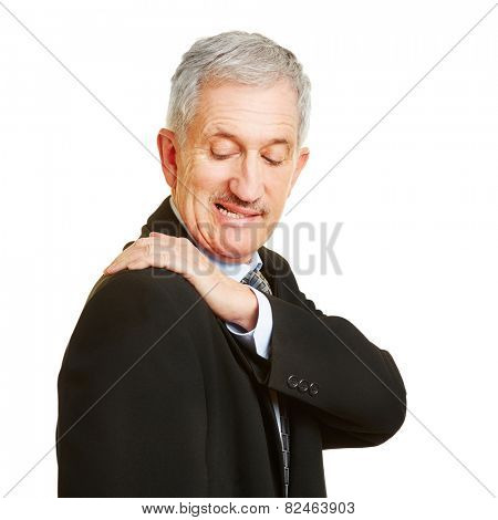 Old man having shoulder pain and holding his aching back