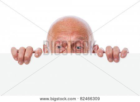 senior peeps over top of blank white paper