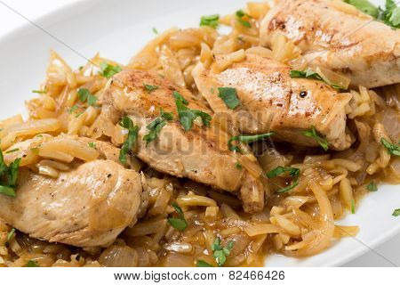 Chicken breasts in an almond, onion and wine sauce, garnished with flat-leaf parsley