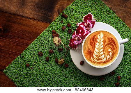 Cup Of Cappuccino On A Green Table