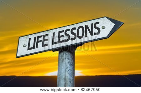 Life Lessons sign with a sunset background