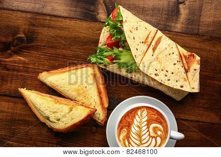 Breakfast With Cappuccino And Sandwich