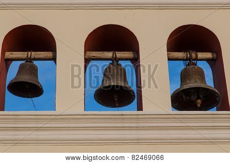 Three Bells From Church With Sky At Background