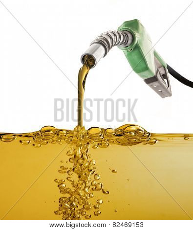 Nozzle pumping gasoline in a tank