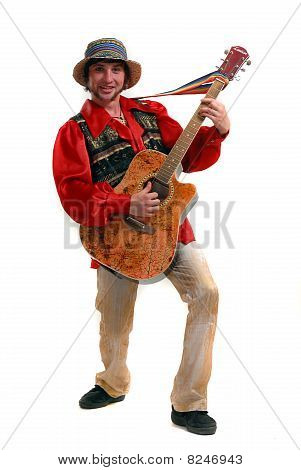 Young man in a hat with a guitar