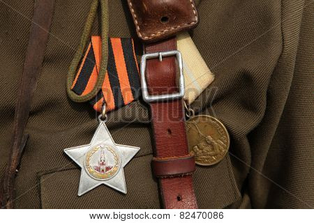 ORECHOV, CZECH REPUBLIC - APRIL 27, 2013: Soviet order of Glory and the Medal for the Defence of Leningrad (R) seen during the re-enactment of the Battle at Orechov (1945) near Brno, Czech Republic.