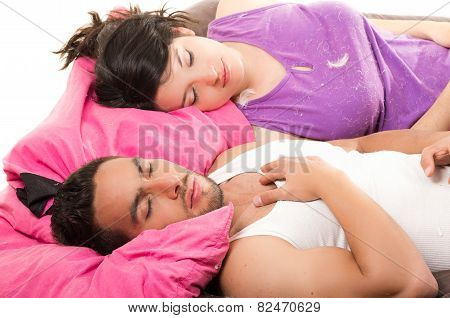 cute attractive couple resting after having a pillow fight