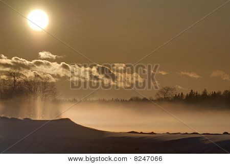 Winter, fog and sunset.