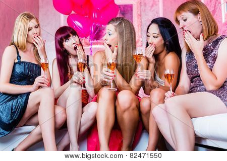 Women partying with champagne in club until morning rises, they are tired