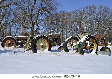 Tractors in a row in the snow