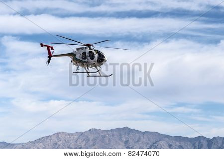 LAS VEGAS, NEVADA, USA - February, 6, 2015:  Las Vegas metropolitan police helicopter on patrol in southern Nevada.