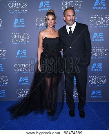 LOS ANGELES - JAN 16:  Kevin Costner & Christine Baumgartner arrives to the Critics' Choice Awards 2015  on January 16, 2015 in Hollywood, CA