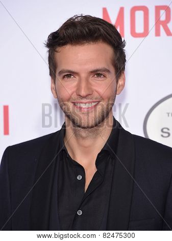 LOS ANGELES - JAN 21:  Guy Burnet arrives to the