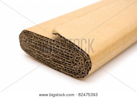 Piece Of Folded Cardboard Corrugated On A White Background