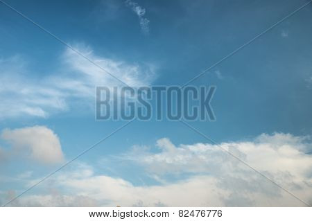 Abstract white cloud over blue sk background with small chinese dragon head shape cloud at one third