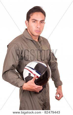 young male hispanic pilot holding helmet