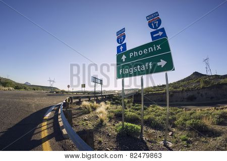 I17 Road sign for Phoenix and Flagstaff, Arizona - options - choice - Fish eye super wide angle view